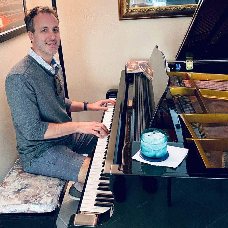 Hidden Talents - Jeff at a Piano With Hands on Keys