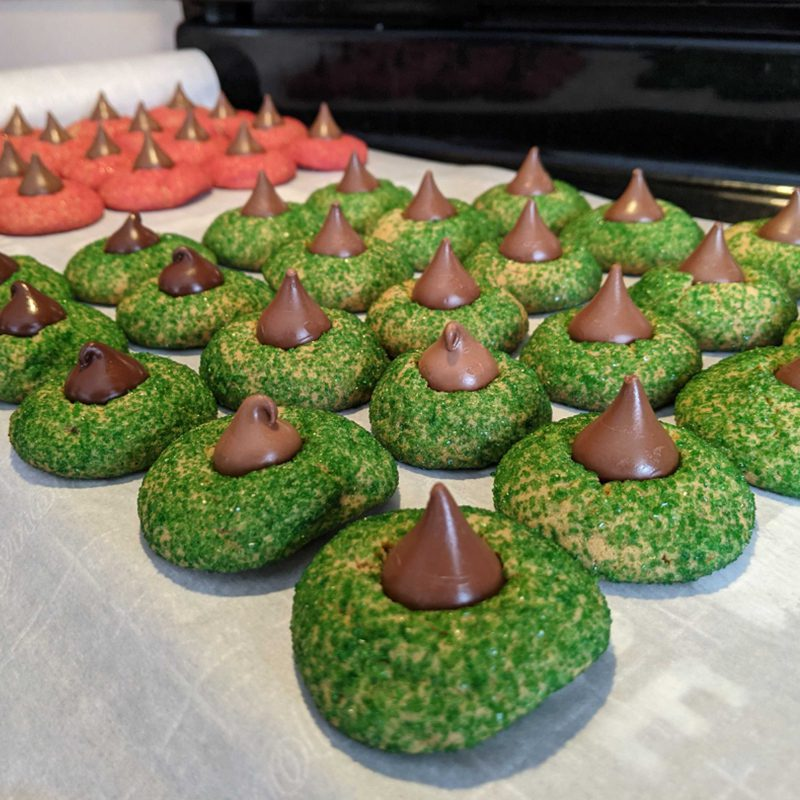Hidden Talents - Rows of Green and Red Cookies With Chocolate Pieces on Top