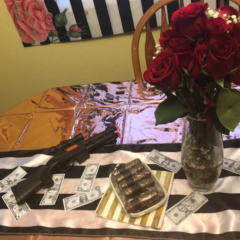 Hidden Talents - Toy Gun, Money, Fake Cigars, and Roses on Table