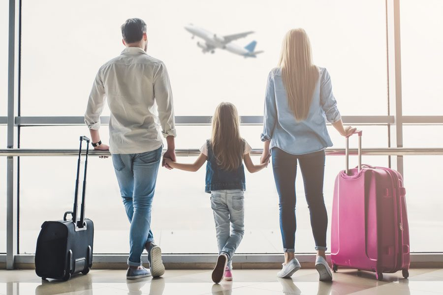Travel Insurance - Family Walking Through the Airport