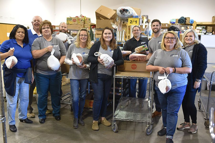 About Our Agency - First Security Insurance Team Volunteering During Thanksgiving