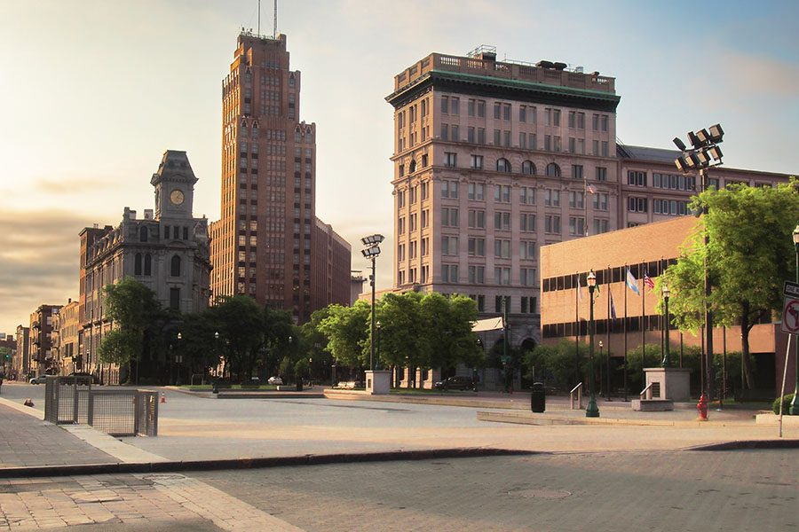 About Our Agency - View of Downtown Syracuse Commercial Buildings at Sunset